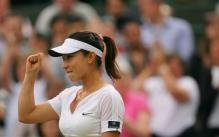 Zheng Jie pumps her fist.jpg