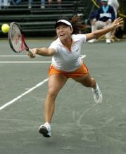 Zheng Jie stretches to return a shot.jpg