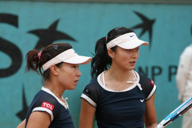 Jie Zheng stands with Yan Zi during a doubles match.jpg