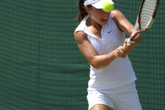 Zheng Jie blisters a two-handed backhand.jpg