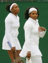 Serena and Venus Williams get ready for their Wimbledon doubles match.jpg