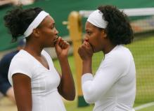 Venus and Serena consult with one another.jpg