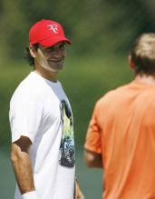 Roger Federer smiles during a training session.jpg