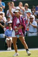 Zheng Jie acknowledges the crowd after winning her quarterfinal match at Wimbledon.jpg