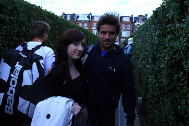 Arnaud Clement poses for a pic with a fan.jpg