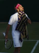 Arnaud Clement wipes himself with a towel in Wimbledon 2008.jpg