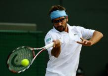 Arnaud Clement hits a forehand.jpg