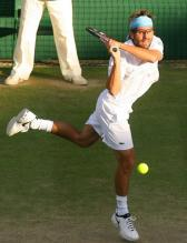 Arnaud Clement hits a two-handed backhand.jpg