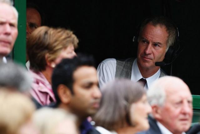 John McEnroe looks on from the press box.jpg