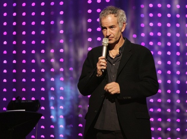 John McEnroe on stage with a mikew.jpg