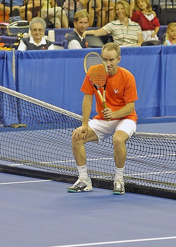 John McEnroe sits on the net.jpg