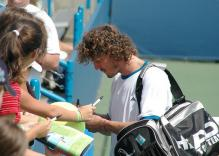 Marat Safin signs autograhs for fans in 2005.jpg