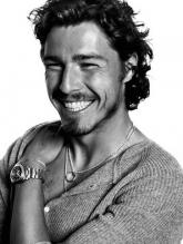 Marat Safin smiles in this black and white photo.jpg