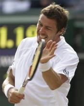 Safin claps hits the racquet face with his hand.jpg