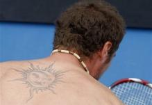 Marat Safin back tattoo of a Sun.jpg