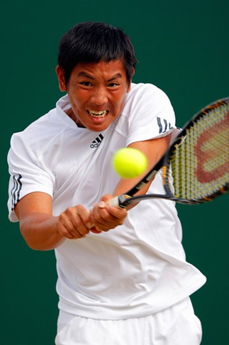 Yang Tsung Hua hits a backhand at Wimbledon.jpg