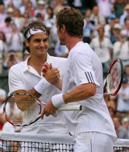 Roger Federer shakes hands with Marat Safin after beating him in the Wimbledon 2008 semifinals.jpg
