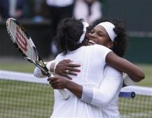 Serena and Venus embrace after winning their Grand Slam doubles championship at Wimbledon.jpg
