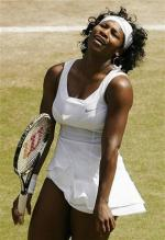Serena reacts dejected after hitting an error.jpg