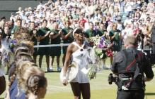 Venus Williams is congratulated for winning Wimbledon for the 5th time in 2008.jpg
