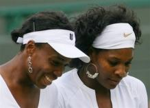 Venus and Serena have a laugh.jpg
