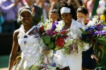 Venus walks off the court victorious after beating little sister Serena.jpg