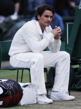 Roger Federer sits and contemplates his 2008 Wimbledon finals loss to Nadal.jpg