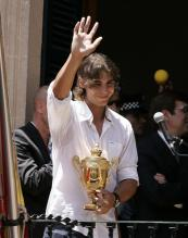 Rafael Nadal waves to his fans at the Manacor town hall balcony.jpg