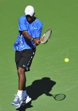 Donald Young hits a two-handed backhand.jpg