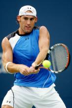 Robby Ginepri hits a 2 handed backhand.jpg