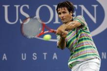 fabrice santoro two handed forehand at contact.jpg