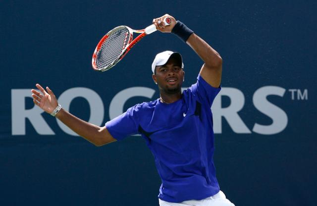 Donald Young spins a forehand.jpg