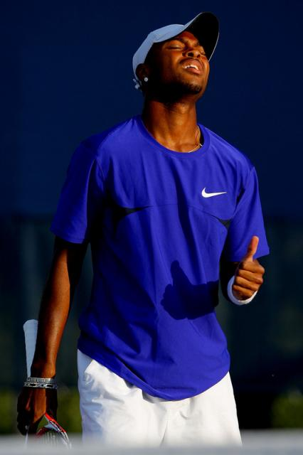 Donald Young is unhappy after getting his serve broken.jpg