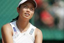 Chan Yung-Jan gets ready to serve.jpg