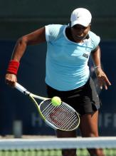 Ahsha Rolle hits a backhand volley.jpg
