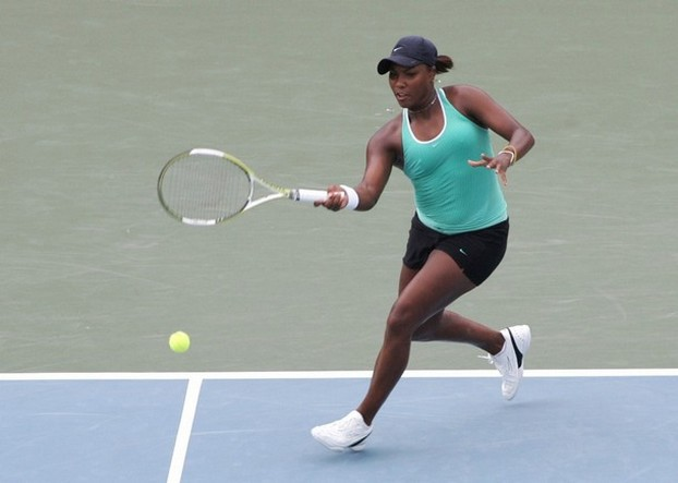 Ahsha Rolle hits a forehand down the line.jpg