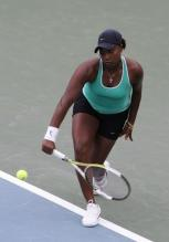 Ahsha Rolle hits a one-handed backhand.jpg