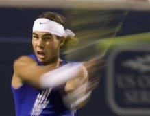 Nadal smacks a backhand.jpg