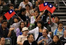 Fans of Chan Yung-Jan and Chuang Chia-Jung wave Taiwan flags.jpg