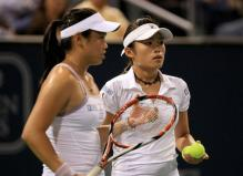 Chan Yung-Jan and her doubles partner Chuang Chia-Jung discuss strategy.jpg