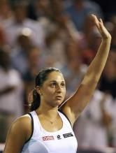 Tamira Paszek raises her arm to akcnowledge the crowd.jpg