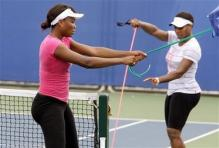 Venus and Serena Williams train during the Beijing Olympics.jpg