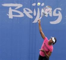 Venus Williams practices a serve at the Beijing Olympics.jpg