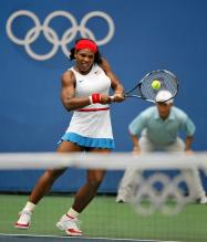 Serena Williams hits a two-handed backhand during the Beijing Olympics.jpg