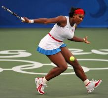 Serena Williams slices a ball durings the Beijing Olympics.jpg