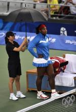 Serena Williams waits for the rain to stop.jpg