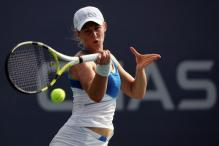 jessica moore forehand at contact.jpg