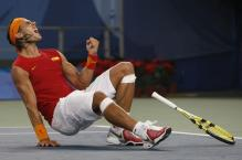 Rafael Nadal falls the the ground after winning the Olympics tennis gold medal 2008.jpg