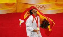 Rafael Nadal relishes the moment on the Olympic podium.jpg