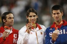 Nadal shows his gold medal alongside Fernando Gonzalez and Novak Djokovic.jpg